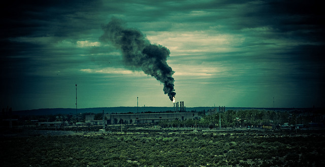 A power station churning out think smoke.