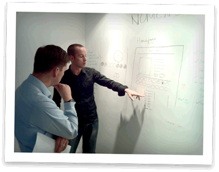 Photo of the guys discussing some wireframe concepts