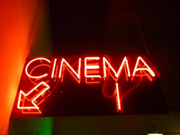 Neon sign that spells the word cinema