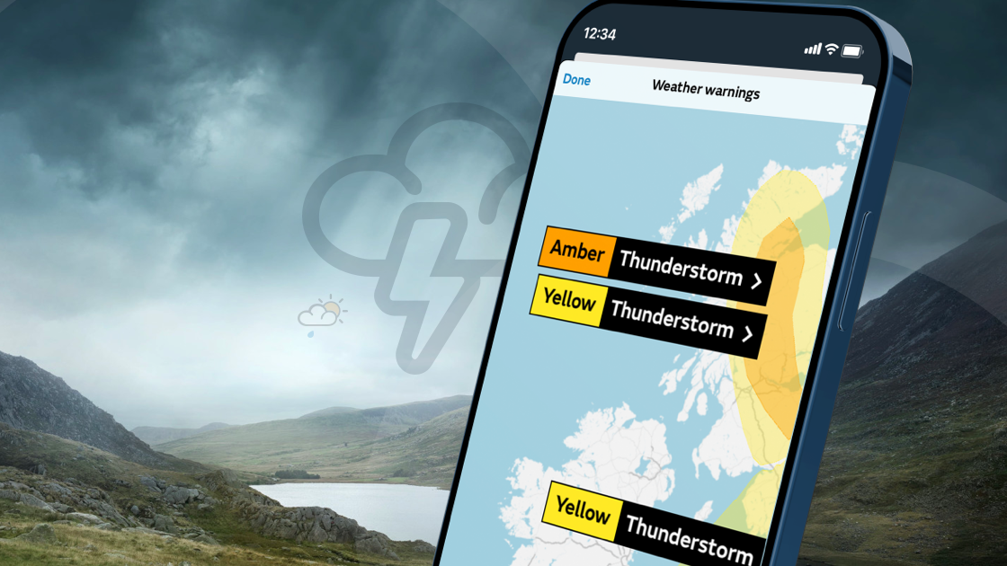 Smartphone with UK map and weather warnings on screen