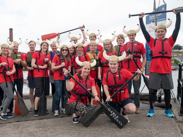 Team-nomensa-celebrating-at-dragon-boat-day