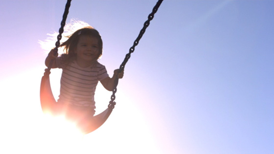 Image of girl on a swing
