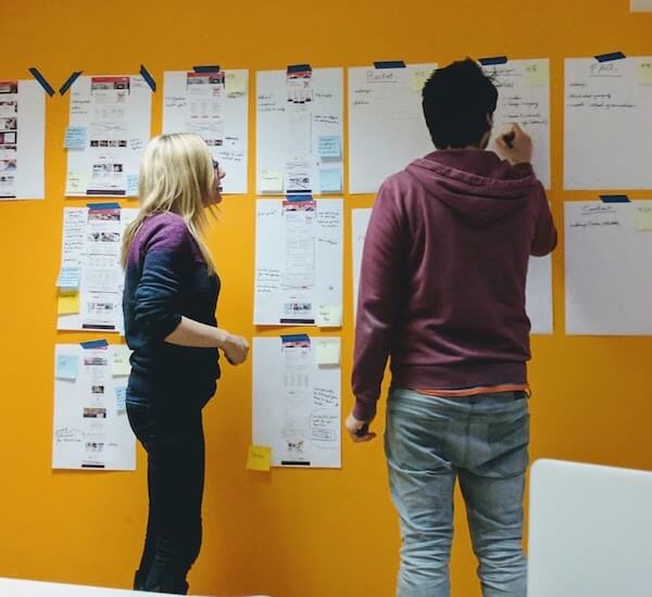 Photograph of two members of Nomensa staff in a UX design session