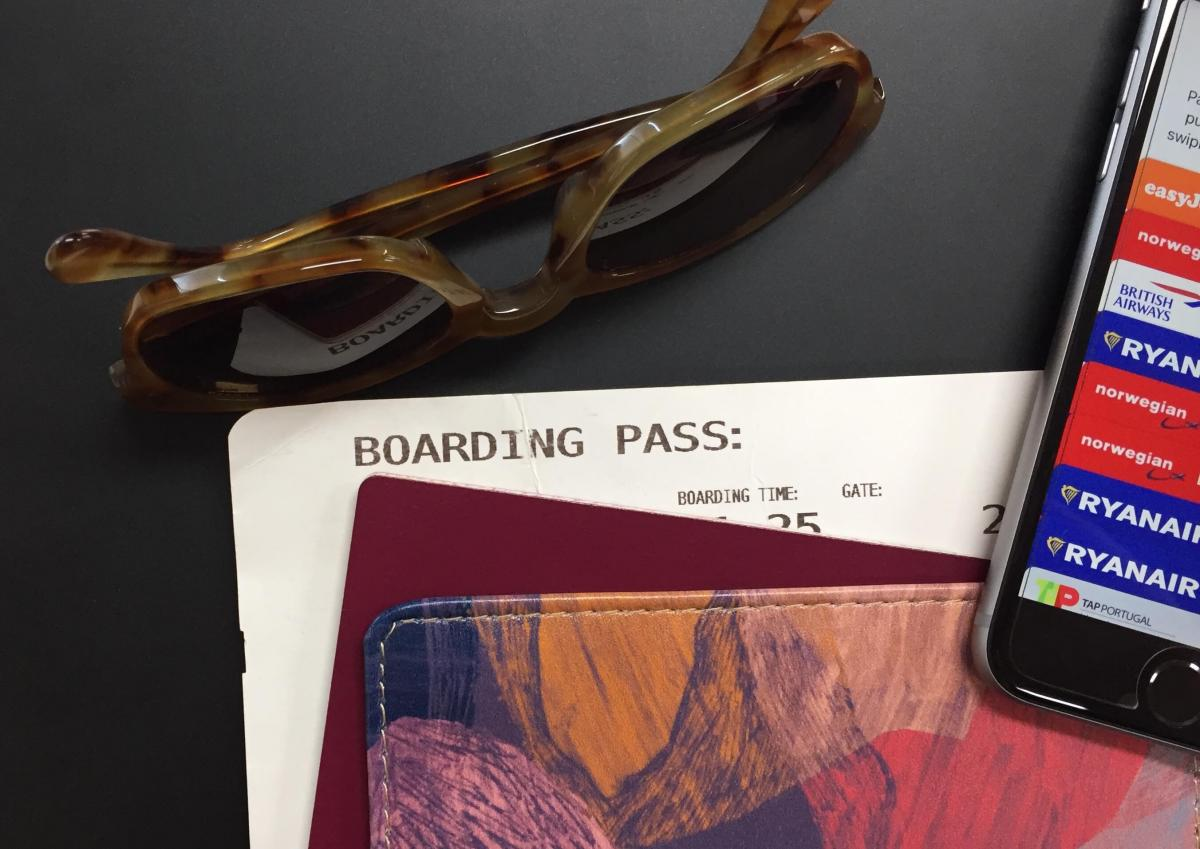 Sunglasses, passport and boarding pass.